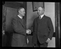 Harold Davis and Asa Keyes, district attorneys, shaking hands, Los Angeles, 1924-1929