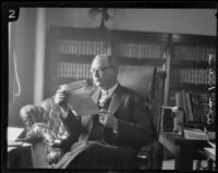 Asa Keyes, district attorney of Los Angeles County, reads a letter in his office, Los Angeles, 1923-1928