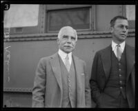 Otto Kahn, investment banker, with an unidentified man, departing at a train station, Los Angeles, 1928