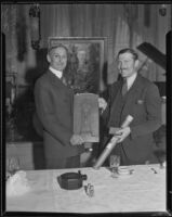 Senator William G. McAdoo presents a plaque and scroll to flyer Col. Roscoe Turner at the Biltmore, Los Angeles, 1933