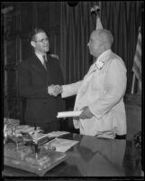 Gordon L. McDonough shaking hands with Governor James Rolph, (probably) Sacramento, circa 1933-1934