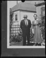 Harry Meagher, murder victim, and an unidentified woman in front of a house, 1930-1933