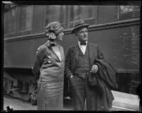 Greta and Robert A. Millikan at a train station, Los Angeles, 1920-1939