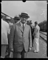 John Thomas, senator from Idaho, at a train station, Los Angeles, 1929-1933