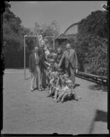 John C. Porter, mayor of Los Angles, with children on a slide, Los Angeles, 1929-1933