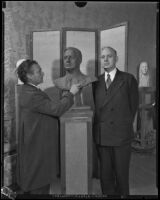 Salvatore Cartiano Scarpitta at work on a bust of mayor John C. Porter in his studio, Los Angeles, 1929-1935