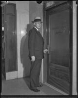 John C. Porter standing in front of the Grand Jury entrance, 1928-1933