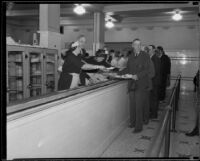 John C. Porter, mayor of Los Angeles, helping in a soup line, Los Angeles, 1929-1933
