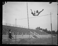 """Clark,"" probably Roland Clark of Pomona College, pole vaulting, circa 1924"