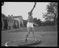 Elmer Gerken of the Berkeley Golden Bears, shot putting, circa 1925