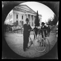 Basilios Kapsambelis (L) and his brother (Dimitrios?) with bicycles in front of the Municipal Theater, Piraeus, 1891