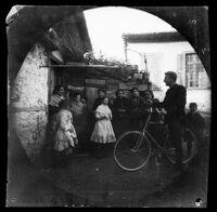 William Sachtleben conversing with women and children on a street, Athens, 1891
