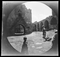William Sachtleben with his bicycle in the ruins of a Seljuk caravansarai during his ride from Kayseri to Sivas, Turkey, 1891