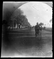 William Sachtleben on bicycle on the road leaving the city of Khoy, Iran, 1891