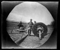 "Iranian man repairing a wagon wheel near ""Dilusan,"" Khoy vicinity, Iran, 1891"