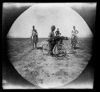 William Sachtleben on bicycle and three Armenian men on horseback on the plains north of Lake Urmia, Iran, 1891