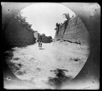William Sachtleben bicycling into a village, (Dizaj Khalil ?), Iran, 1891
