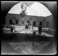 Thomas Allen and William Sachtleben viewing a badger at the zoo of the Prince of Persia, Tabrīz, Iran, 1891