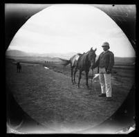 Ed Folsche, telegraph operator, with his horse near a bridge, Miyānah, Iran, 1891