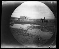 Ed Folsche, telegraph operator, on his horse observing a bridge under construction, Miyānah, Iran, 1891