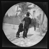 Archibald Loudon Snowden and his pet dog Nibbings before the U. S. Embassy, Athens, 1891