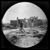 Thomas Allen standing next to his bicycle in front of the Propylaea, Athens, 1891