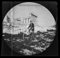 Thomas Allen riding a bicycle on the Acropolis with the Parthenon behind him, Athens, 1891