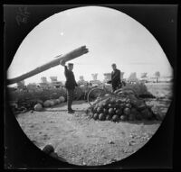 Thomas Allen and William Sachtleben next to a mound of cannonballs on the Acropolis, Athens, 1891