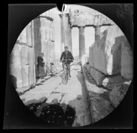 Thomas Allen riding his bicycle within the north colonnade of the Parthenon as William Sachtleben watches, Athens, 1891