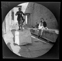 Thomas Allen poses on his bicycle on a block of marble at the Propylaea, Athens, 1891