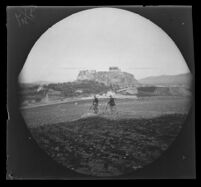 William Sachtleben and Thomas Allen on Philopappos Hill with the Acropolis in the distance, Athens, 1891