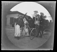 William Sachtleben, with his bicycle, with a group of Carnival masqueraders, Piraeus, 1891