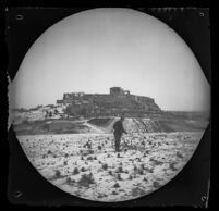 William Sachtleben with his bicycle in a view of the Acropolis taken from Philopappos Hill, Athens, 1891
