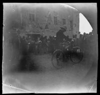 William Sachtleben preparing to ride his bicycle before a gathered crowd, Kayseri, Turkey, 1891