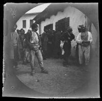 Men gathered on a narrow street, (Endires?), Turkey, 1891