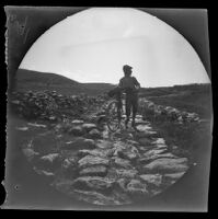 William Sachtleben walking with his bicycle on a (Roman?) road, (Erzurum vicinity?), Turkey, 1891