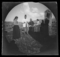 Yuseph Effendi Tartarian with his family and William Sachtleben on his sod roof top, Erzurum, Turkey, 1891