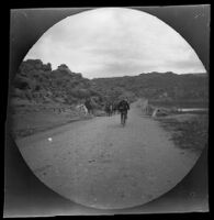 William Sachtleben riding his bicycle on the road leading to the old bridge from the mountains east of Geyve, Turkey, 1891