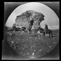 William Sachtleben riding a horse and Thomas Allen with his bicycle next to a Roman ruin, Ankara vicinity, Turkey, 1891