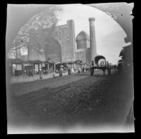 Sher-Dor Madrasah seen from the road lined with market stalls, Samarqand, Uzbekistan, 1891
