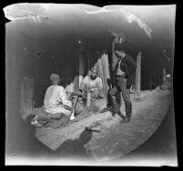 William Sachtleben watching a man operate a grindstone at a street market, Samarqand, Uzbekistan, 1891