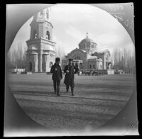 William Sachtleben and Johann Balinski strolling in front of the St. George Cathedral or Joseph-George Cathedral and bell tower, Tashkent, Uzbekistan, 1891