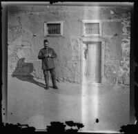 Man standing outside an Armenian house after the October 30th massacre, Erzurum, Turkey, 1895