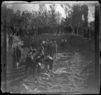 Armenian massacre victims interred in a mass grave in the Armenian Gregorian Cemetery, Erzurum, Turkey, 1895