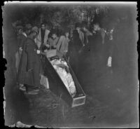 Armenian massacre victim in a coffin in the Armenian Gregorian Cemetery, Erzurum, Turkey, 1895