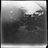 Thomas Allen looking at melons at an outdoor market, Bukhoro, Uzbekistan, 1891