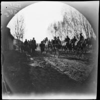 On a road near the bazaars, Thomas Allen on his bicycle as curious Kirghiz and Sarts follow on horseback, Chinaz, Uzbekistan, 1891