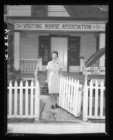 Florence Peters leaves the office of the Visiting Nurse Association, Los Angeles, 1946