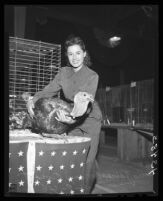 Mary Oviatt with a turkey at the Hemet Turkey Show, Hemet, 1946