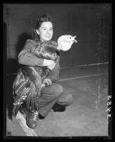 Mary Oviatt with a turkey at the Hemet Turkey Show, Hemet, 1946